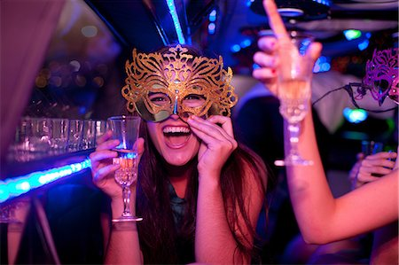 Young woman wearing mask with wine glass in limousine Stock Photo - Premium Royalty-Free, Code: 649-06844361
