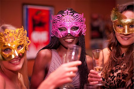 Young women wearing masquerade masks at hen party Stock Photo - Premium Royalty-Free, Code: 649-06844385