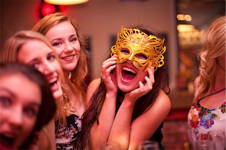Young woman wearing masquerade mask at hen party Stock Photo - Premium Royalty-Free, Code: 649-06844386
