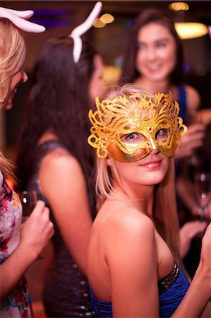 Young woman wearing masquerade mask at hen party Stock Photo - Premium Royalty-Free, Code: 649-06844382