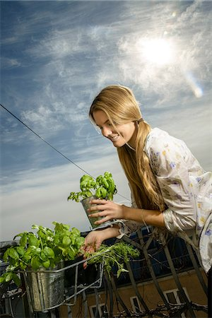 Young woman holding pot plant Stock Photo - Premium Royalty-Free, Code: 649-06844409