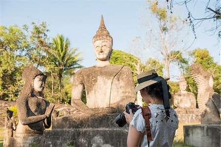 Woman photographing statue, Xieng Khu, Vientiane, Laos Stock Photo - Premium Royalty-Free, Code: 649-06844455