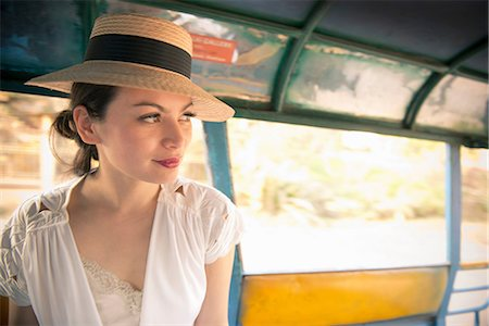 Woman wearing hat on rickshaw Stock Photo - Premium Royalty-Free, Code: 649-06844457