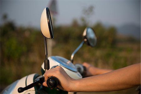 Woman's hands on moped handlebars Stock Photo - Premium Royalty-Free, Code: 649-06844505