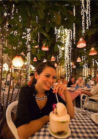 Woman drinking exotic drink in outdoor restaurant Stock Photo - Premium Royalty-Free, Code: 649-06844510