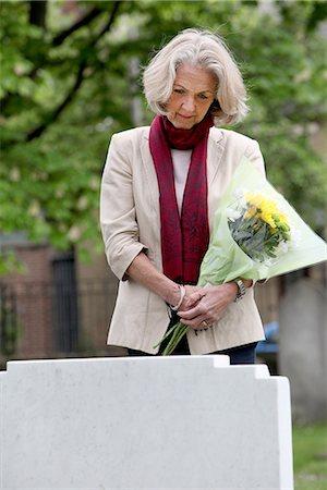 dead woman - Senior woman holding flowers in graveyard Stock Photo - Premium Royalty-Free, Code: 649-06844549