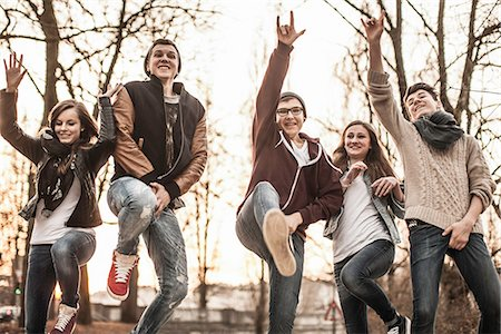 female crotch - Five teenagers fooling around, jumping in park Stock Photo - Premium Royalty-Free, Code: 649-06844610