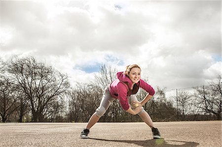 stretching (people exercising) - Woman doing stretching exercise Stock Photo - Premium Royalty-Free, Code: 649-06844937