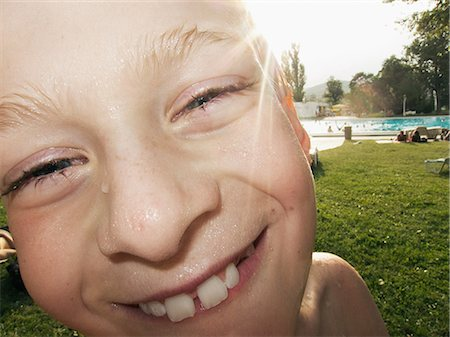 Boy with wet face smiling, portrait Stock Photo - Premium Royalty-Free, Code: 649-06845001
