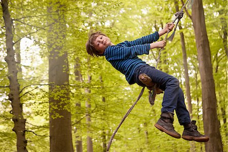swing (sports) - Boy swinging on rope in forest Stock Photo - Premium Royalty-Free, Code: 649-06845016