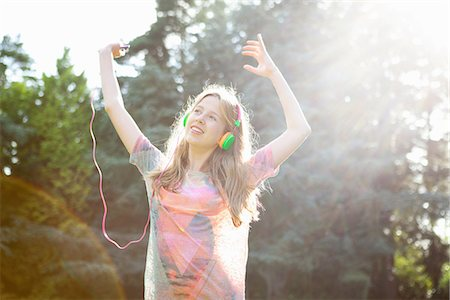 dancing - Teenage girl listening to mp3 player and dancing Stock Photo - Premium Royalty-Free, Code: 649-06845012