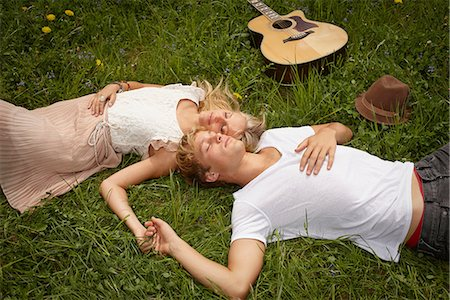 Young couple lying on grass with eyes closed Stock Photo - Premium Royalty-Free, Code: 649-06845161