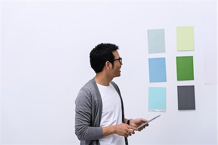 decision - Young male designer looking at color swatch Stock Photo - Premium Royalty-Free, Code: 649-06845182