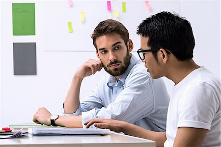 designer - Two young designers discussing ideas Stock Photo - Premium Royalty-Free, Code: 649-06845190