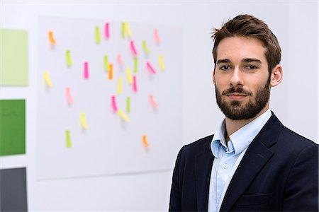 Portrait of young man in design studio Stock Photo - Premium Royalty-Free, Code: 649-06845193
