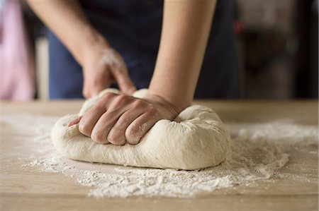 Hands kneading bread dough Stock Photo - Premium Royalty-Free, Code: 649-06845217