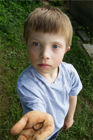 Close up portrait of boy with a worm in his hand Stock Photo - Premium Royalty-Free, Code: 649-06845253