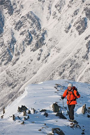 Female climber walking up snow covered ridge Stock Photo - Premium Royalty-Free, Code: 649-06845278