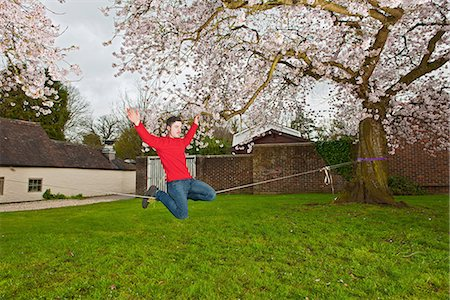 extremism - Young man balancing on a slackline Stock Photo - Premium Royalty-Free, Code: 649-06845279