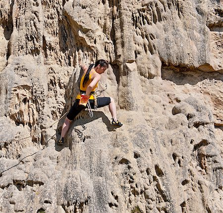 Female rock climber on rock face Stock Photo - Premium Royalty-Free, Code: 649-06845287