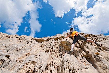 rock climber - Female rock climber nearing cliff top Stock Photo - Premium Royalty-Free, Code: 649-06845288