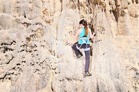 rock climber - Teenage rock climber on rock face Stock Photo - Premium Royalty-Free, Code: 649-06845289
