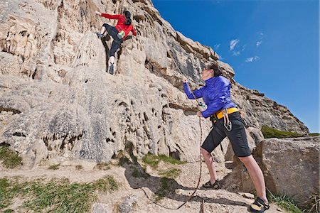 Female rock climbers near cliff base Stock Photo - Premium Royalty-Free, Code: 649-06845290