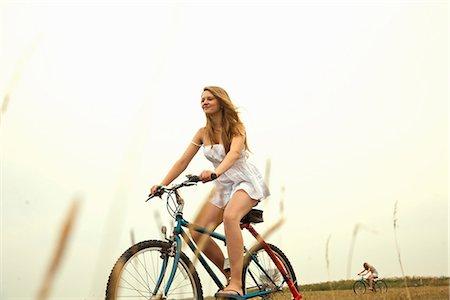 Girl riding bike Stock Photo - Premium Royalty-Free, Code: 649-06843979