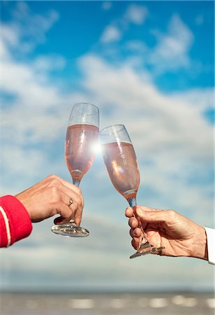 Couple toasting with pink champagne Stock Photo - Premium Royalty-Free, Code: 649-06843970