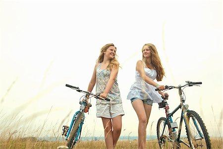 Girls with bikes Stock Photo - Premium Royalty-Free, Code: 649-06843983
