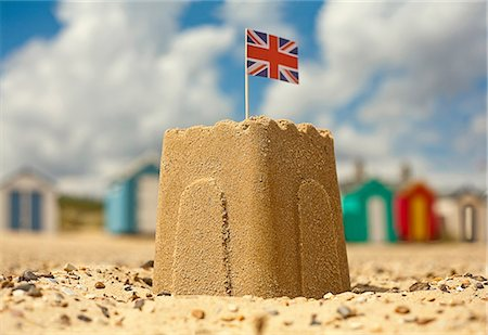 Sandcastle with british flag Stock Photo - Premium Royalty-Free, Code: 649-06843999