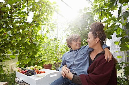 Mother and son sitting outdoors Stock Photo - Premium Royalty-Free, Code: 649-06943770