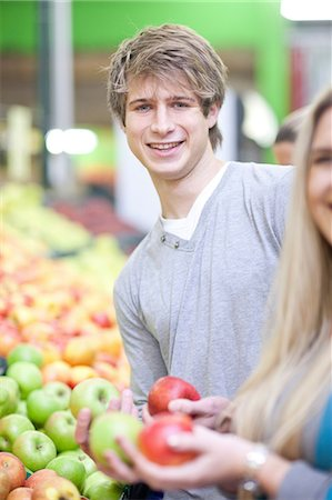 sweater - Young couple with apples in indoor market Stock Photo - Premium Royalty-Free, Code: 649-07064033