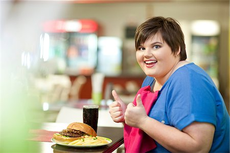 fat lady sitting - Young woman in cafe with unhealthy meal Stock Photo - Premium Royalty-Free, Code: 649-07064043