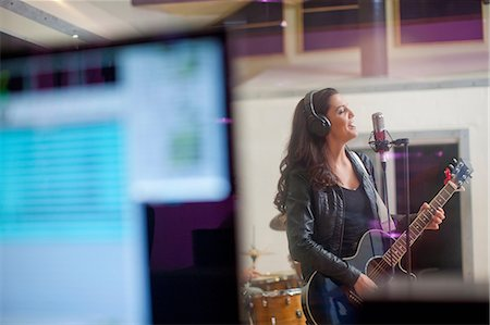 Young woman recording in studio Stock Photo - Premium Royalty-Free, Code: 649-07064118