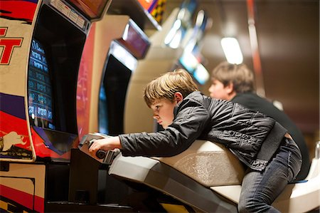 Two young brothers playing on driving video games Stock Photo - Premium Royalty-Free, Code: 649-07064112