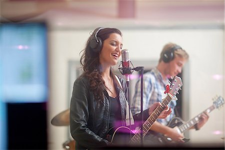 Young band playing music in recoding studio Stock Photo - Premium Royalty-Free, Code: 649-07064122