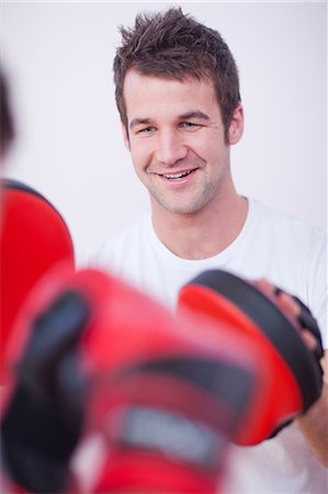 practise - Close up of personal trainer in gym Stock Photo - Premium Royalty-Free, Code: 649-07064137