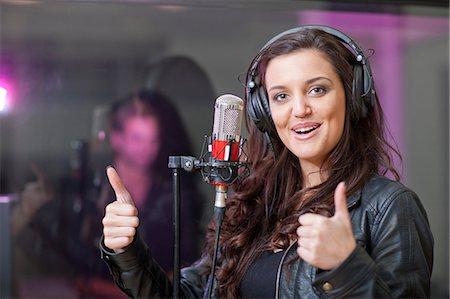 Female singer in recording studio Stock Photo - Premium Royalty-Free, Code: 649-07064132