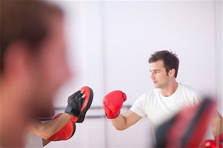 practise - Young man and trainer boxing in sports hall Stock Photo - Premium Royalty-Free, Code: 649-07064144