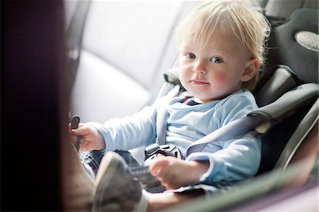 Baby boy in back seat of car Stock Photo - Premium Royalty-Free, Code: 649-07064198