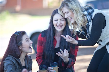 fingers holding - Group of young women fooling about Stock Photo - Premium Royalty-Free, Code: 649-07064209