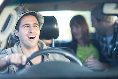 Young adult friends driving in car Stock Photo - Premium Royalty-Free, Code: 649-07064222