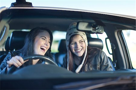 Two young women driving car Stock Photo - Premium Royalty-Free, Code: 649-07064231