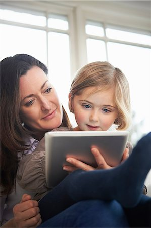 Mother and daughter using digital tablet Stock Photo - Premium Royalty-Free, Code: 649-07064268
