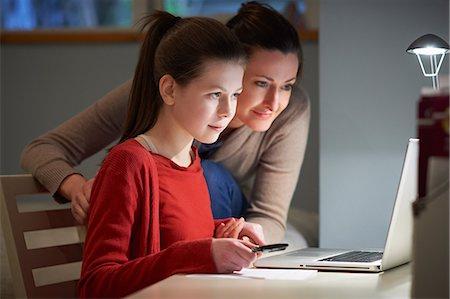 Girl using laptop computer Stock Photo - Premium Royalty-Free, Code: 649-07064282