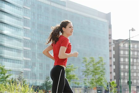 Young woman jogging in city Stock Photo - Premium Royalty-Free, Code: 649-07064316