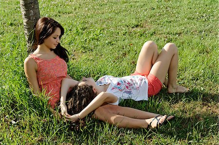 Two young women lounging on grass Stock Photo - Premium Royalty-Free, Code: 649-07064325