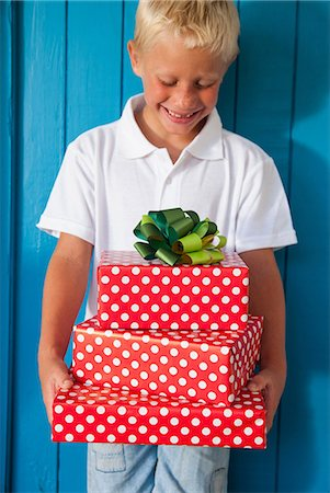 Boy looking down at gifts Stock Photo - Premium Royalty-Free, Code: 649-07064408