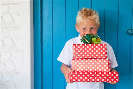 Boy excited at gifts Stock Photo - Premium Royalty-Free, Code: 649-07064409